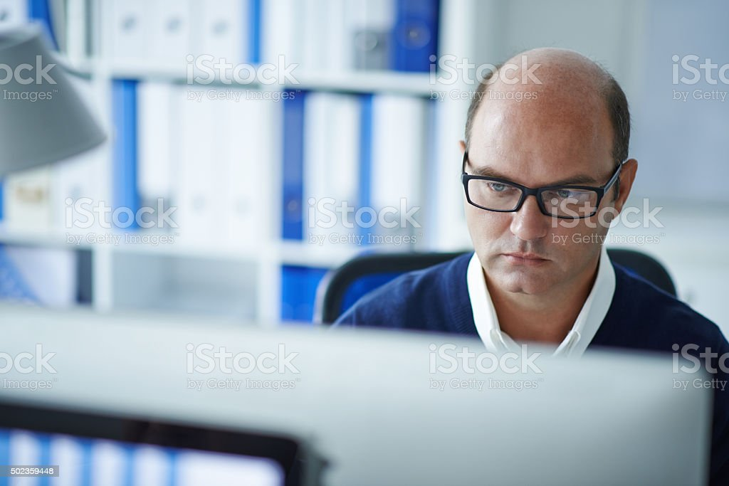 Concentrated on work stock photo