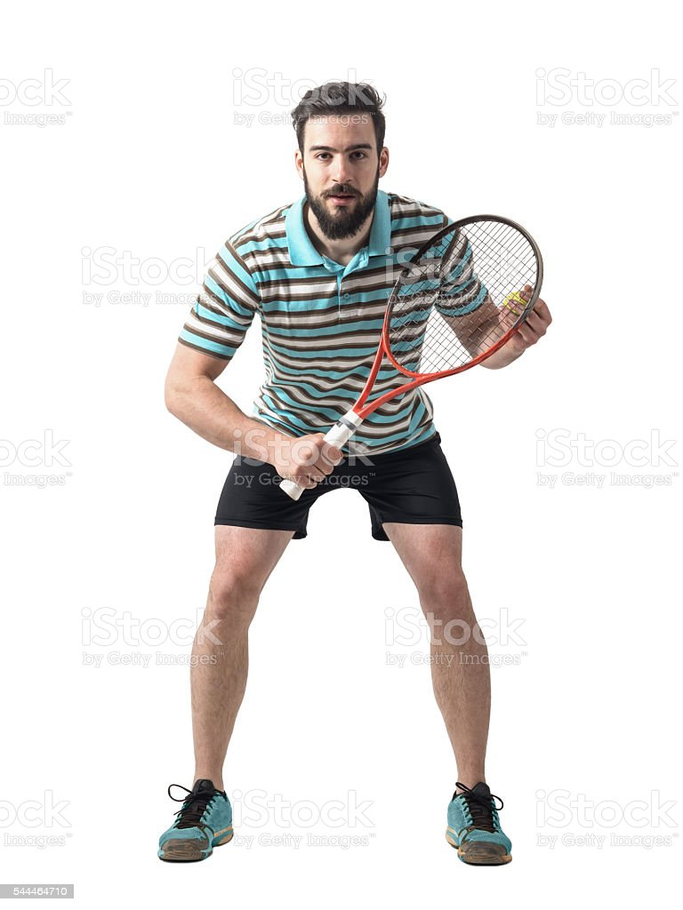 Concentrated tennis player bending and waiting for serve. stock photo