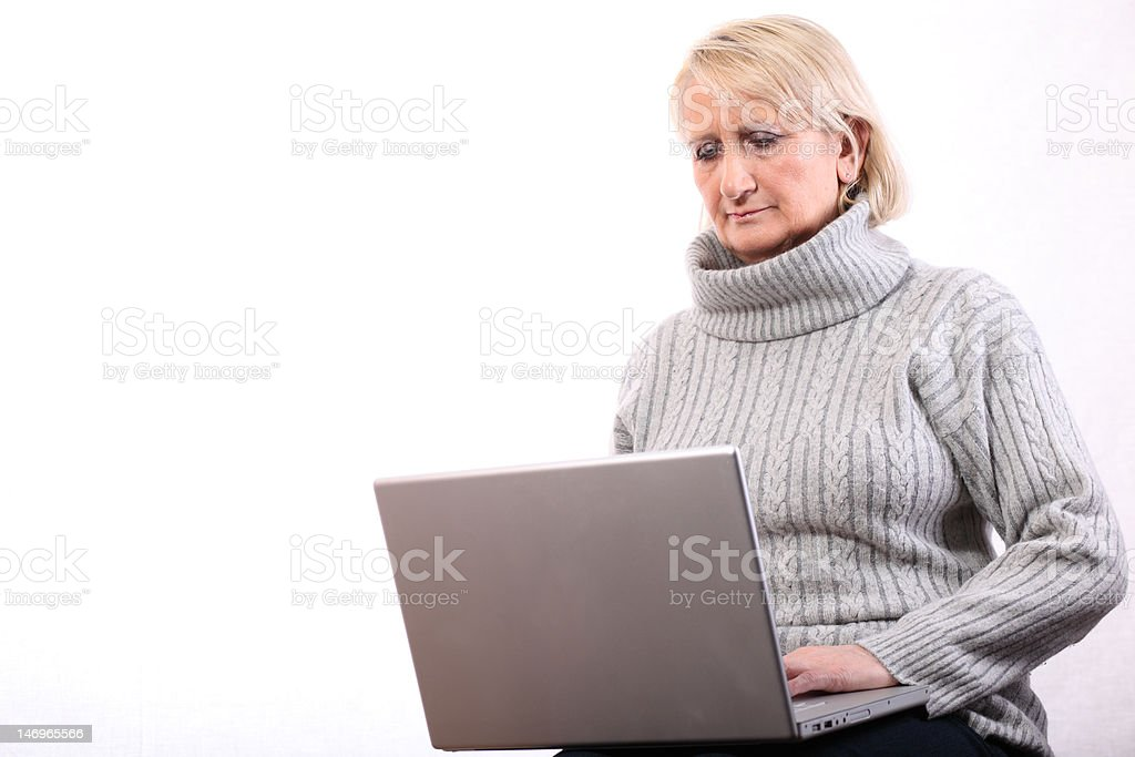 concentrated woman with computer royalty-free stock photo