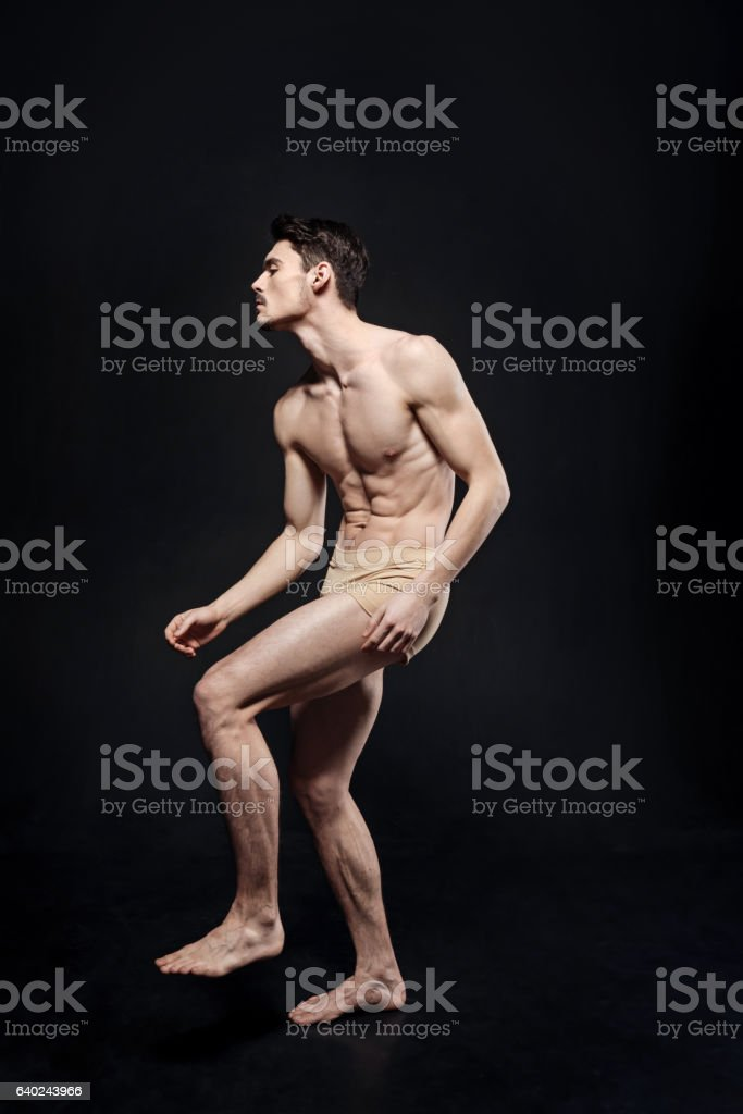 Concentrated young ballet dancer performing in the studio stock photo