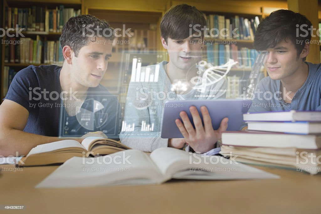 Concentrated young men studying medicine together with futuristic interface stock photo