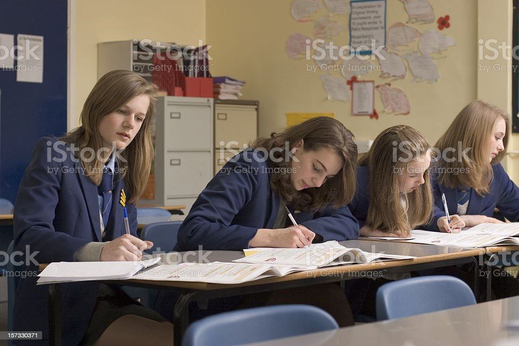 Concentrating girls stock photo