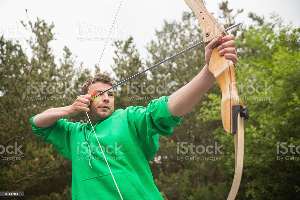 Concentrating man practicing archery stock photo