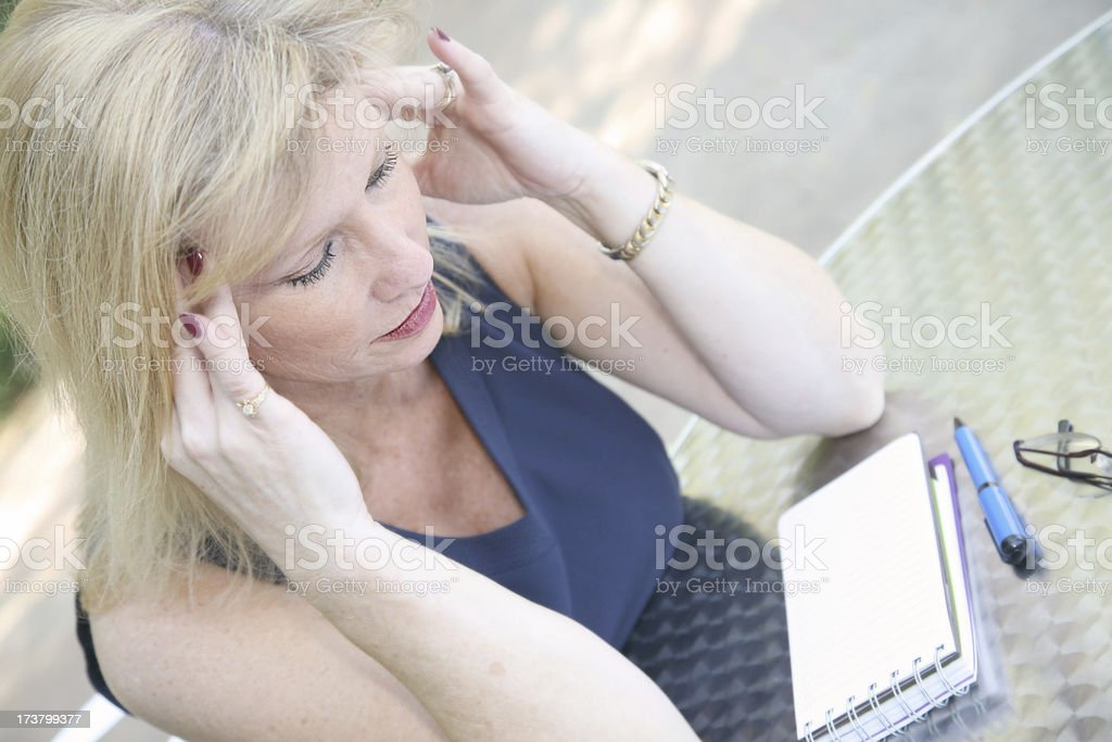 Concentrating Woman Figuring Out What To Do royalty-free stock photo