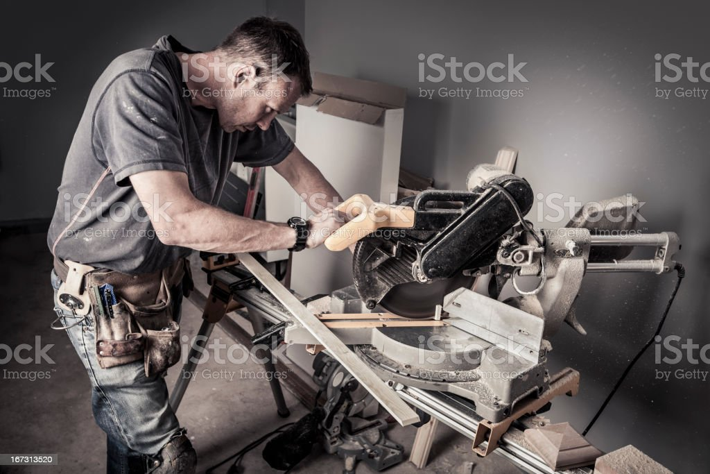 Concentration:  Carpenter at work stock photo