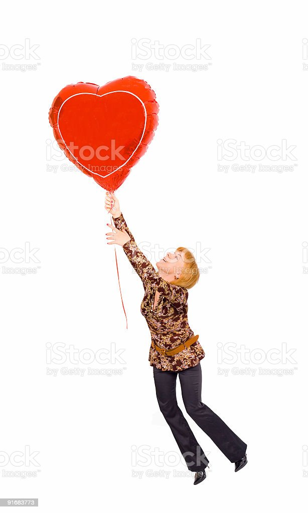 concept - a girl is flying on heart-shaped baloon royalty-free stock photo