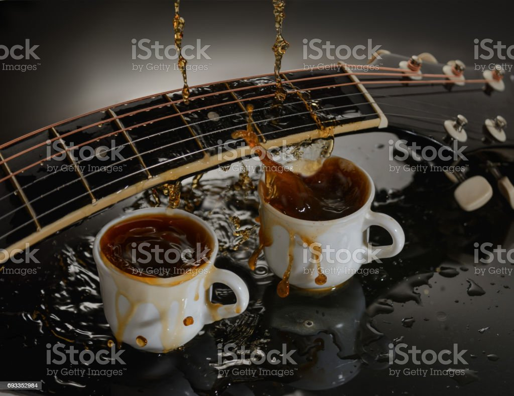Concept acoustic guitar and two cups of coffee. stock photo