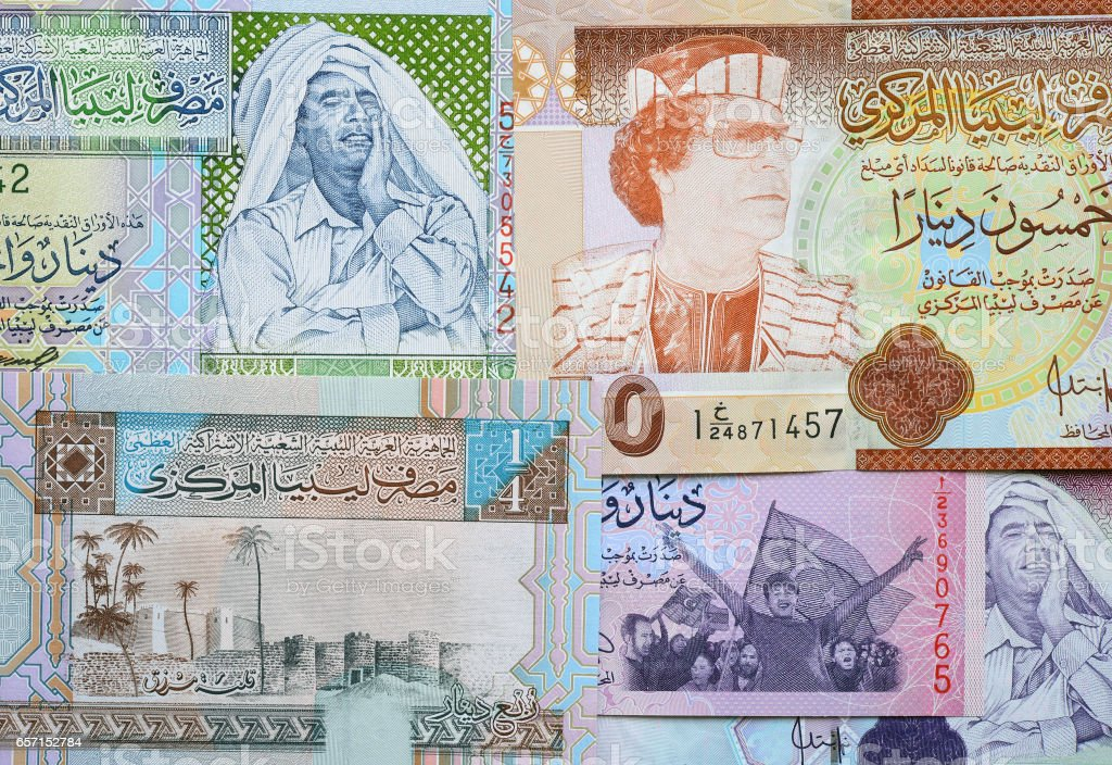 Concept: Arab spring. Muammar Gaddafi on Libya 50 dinar (2008) banknote stock photo