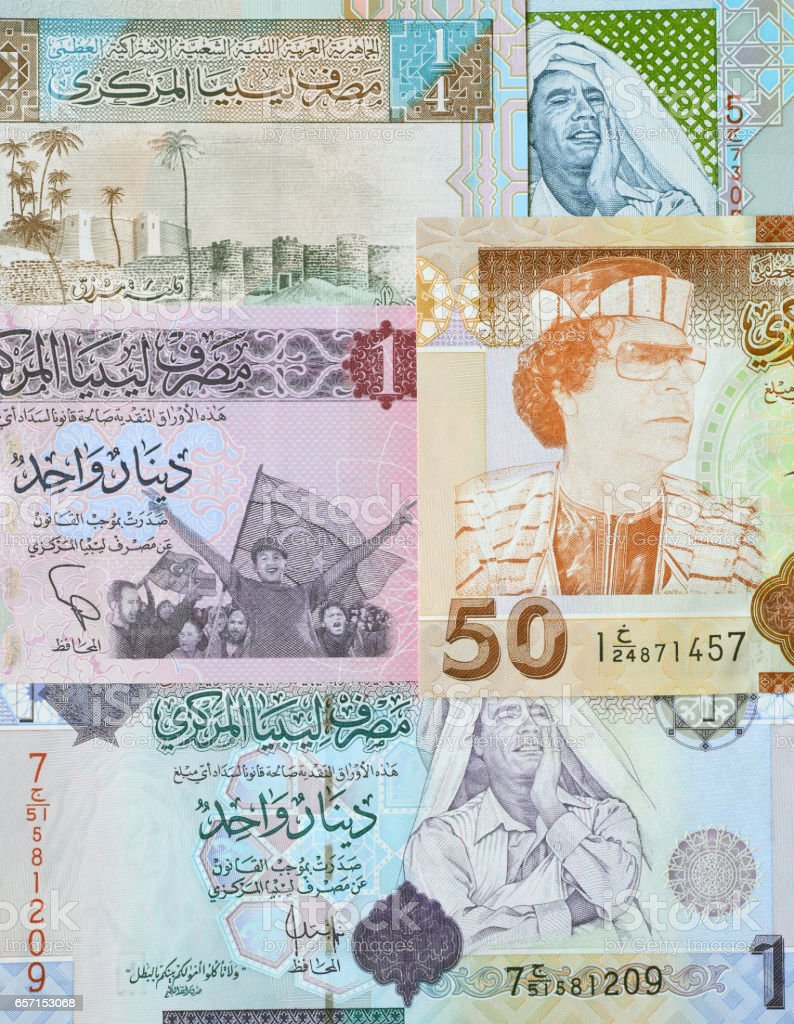 Concept: Arab spring. Muammar Gaddafi on Libya dinar banknote stock photo