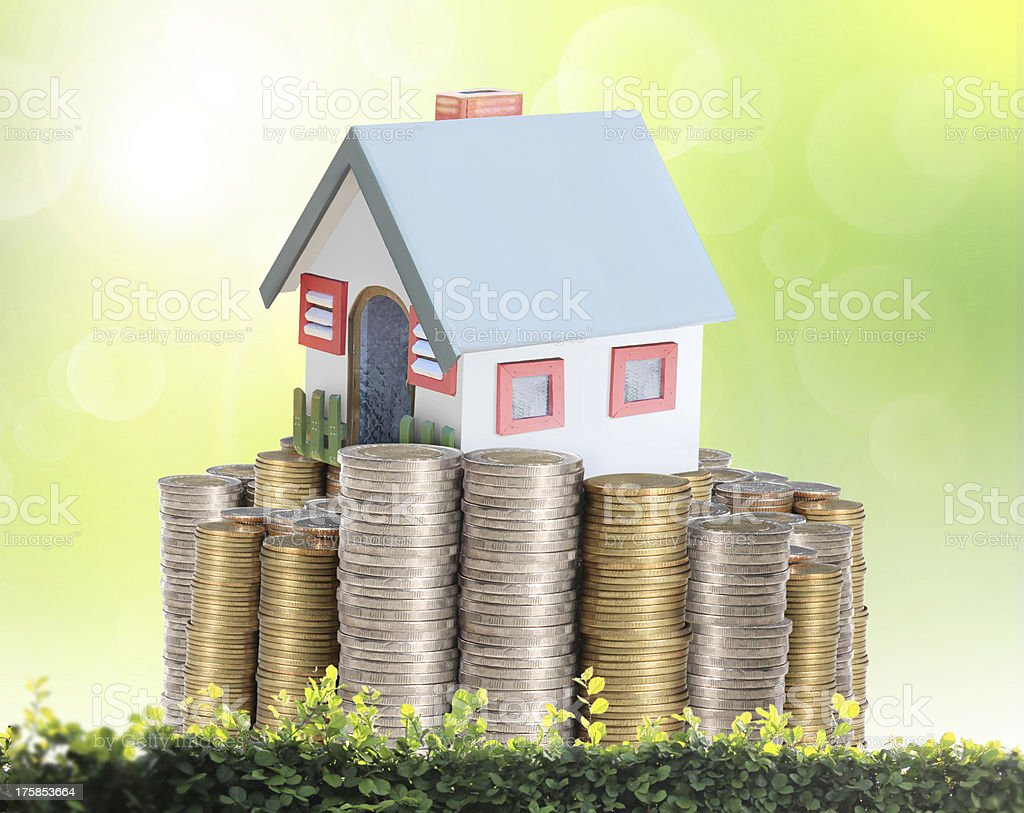 concept by money house from coins stock photo