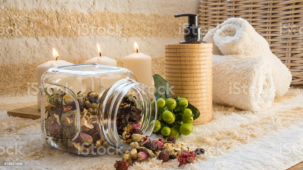 SPA concept - candles, towels, oil and herbs stock photo