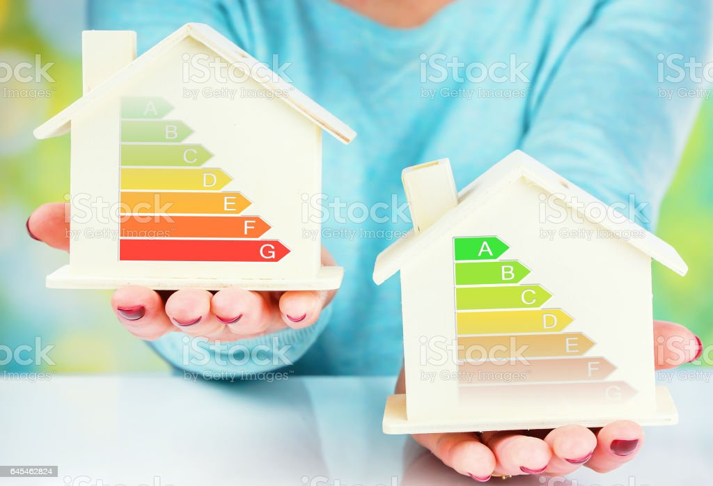 concept comparison between normal house and low consumption house with energy efficiency rating stock photo