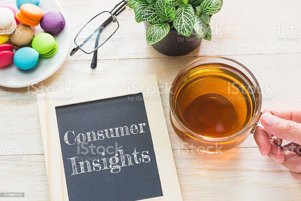 Concept Consumer Insights message on wood boards. stock photo