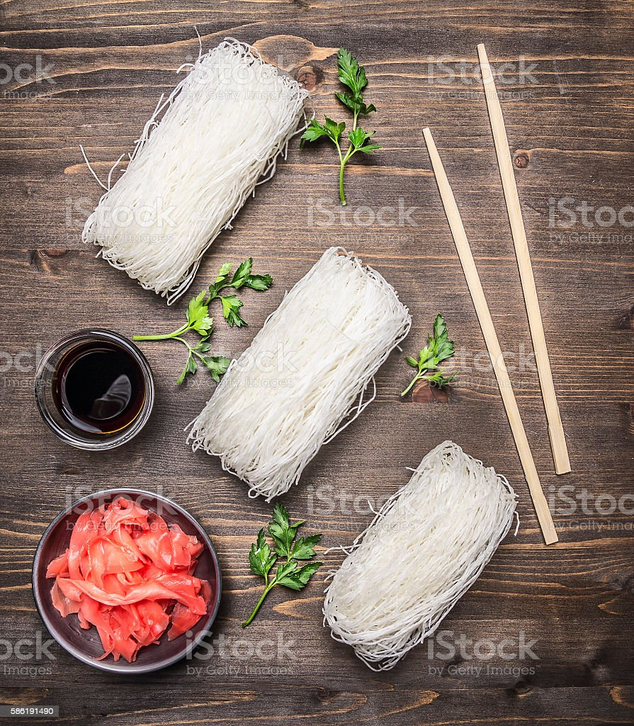 concept cooking Korean food, glass noodles herbs wooden rustic background stock photo