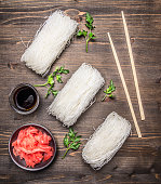 concept cooking Korean food, glass noodles herbs wooden rustic background