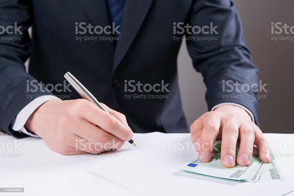 Concept - corruption. Giving a bribe. Money in hand stock photo