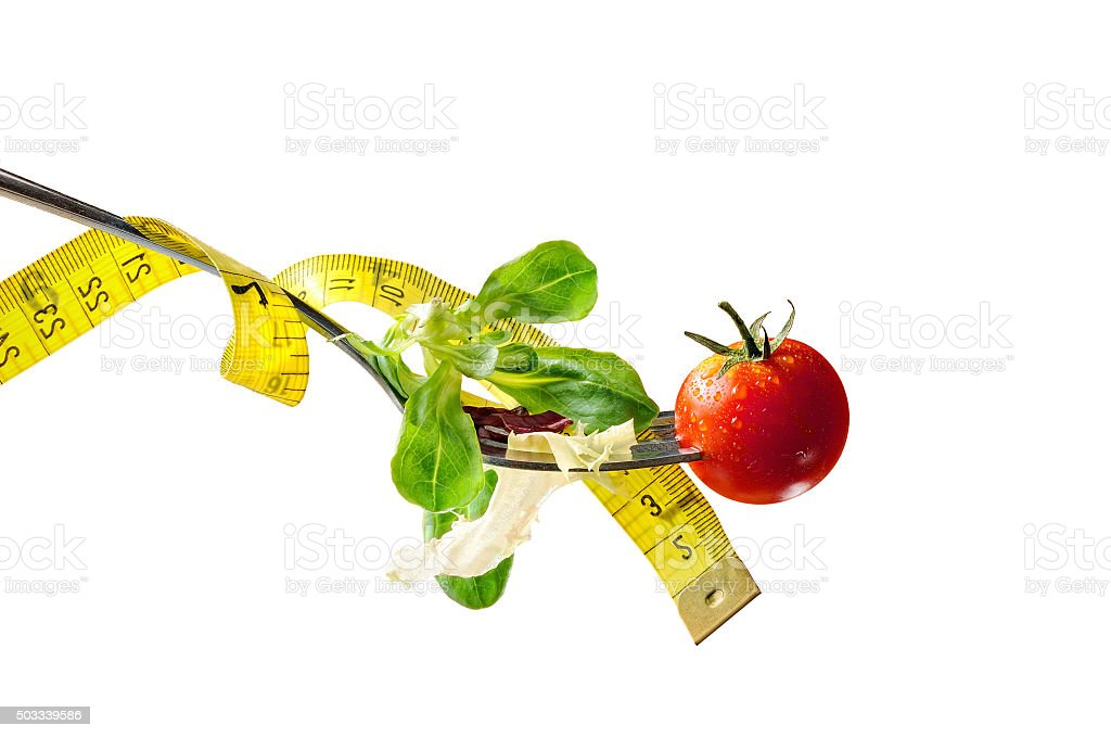 Concept diet fork with salad and metro horizontal composition is stock photo