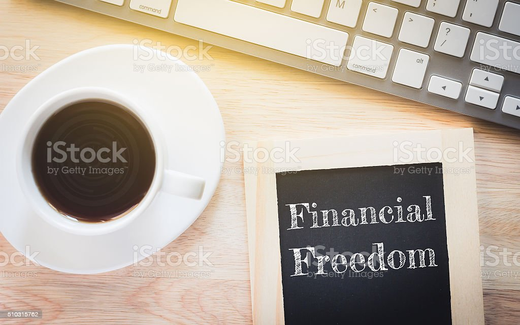 Concept Financial Freedom message on wood boards. stock photo