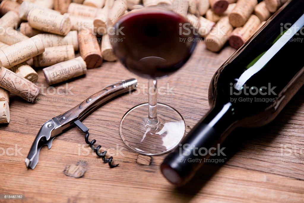 concept flatlay still life with bottle glass wine corks corkscrew stock photo
