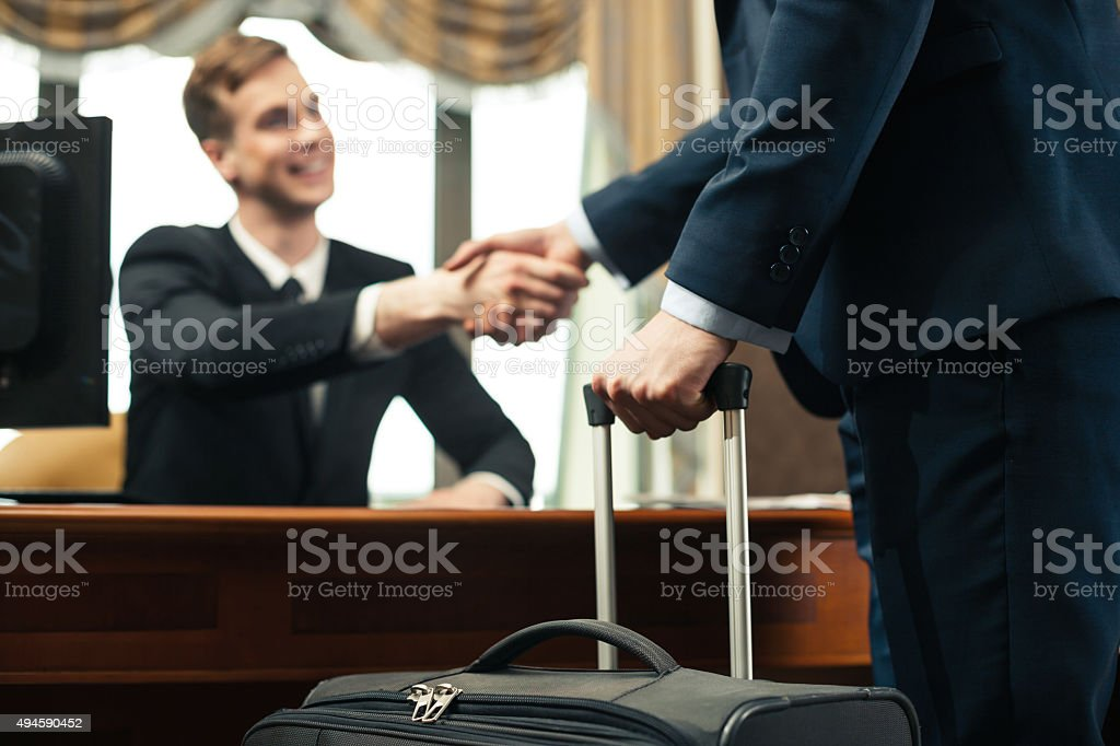 Concept for receptionist and client in hotel stock photo