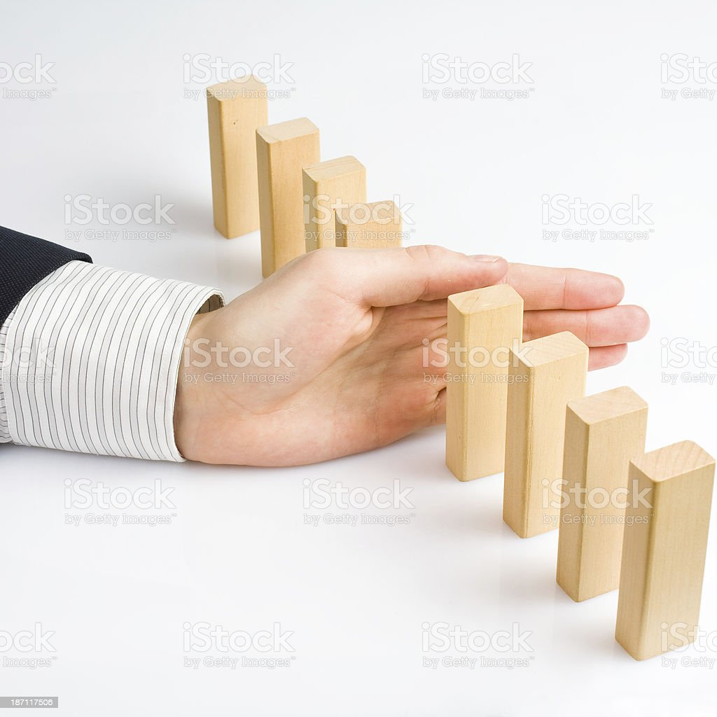 Concept for solution to a problem by stopping domino effect stock photo