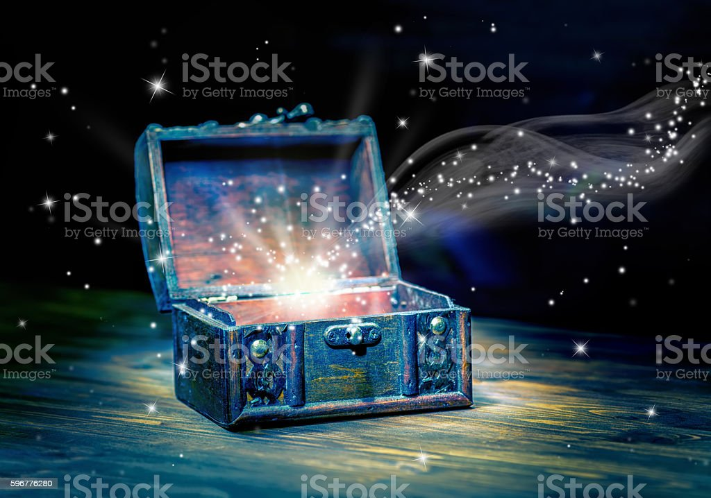 concept greeting card of opened chest treasure with mystical stock photo