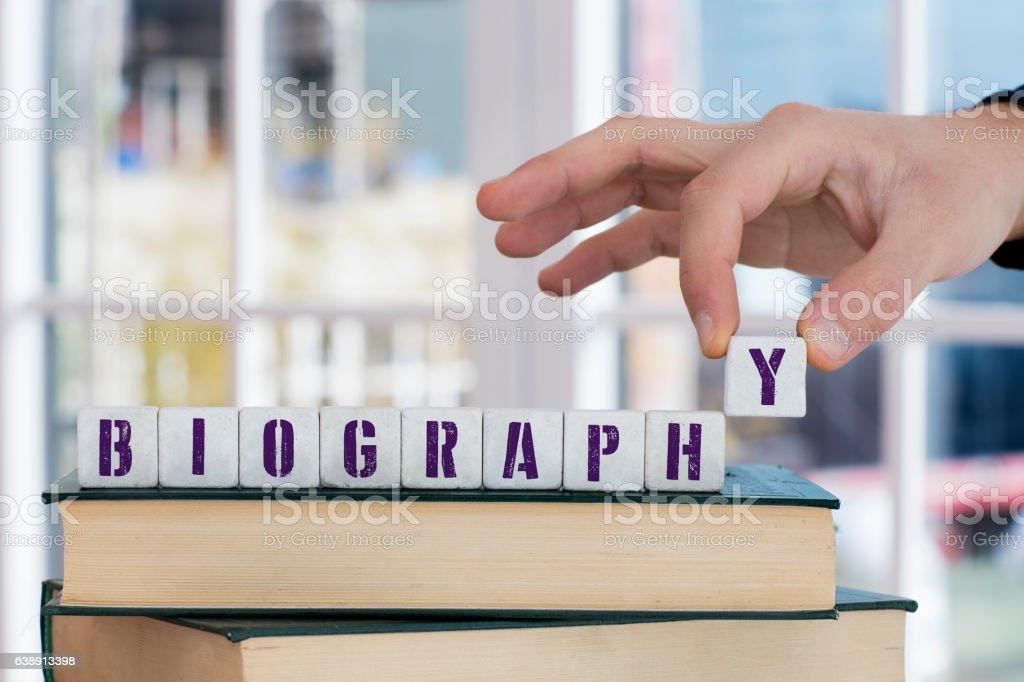 BIOGRAPHY Concept , Hand with alphabet blocks stock photo