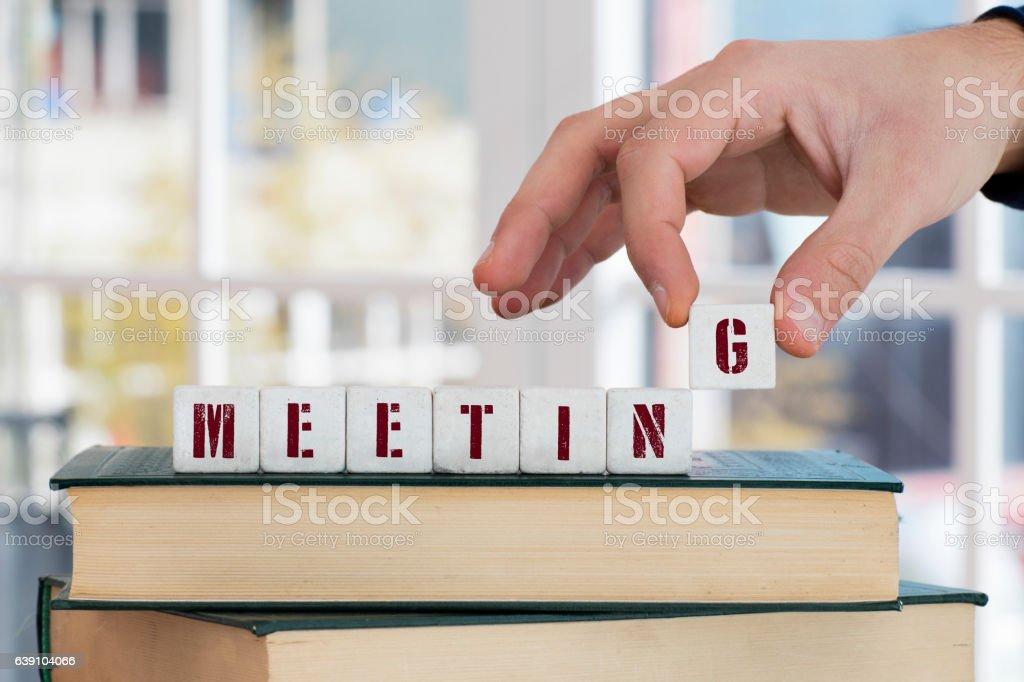 MEETING Concept , Hand with alphabet blocks stock photo