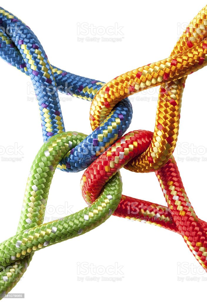 Concept image. Colored ropes tied into a knot. stock photo
