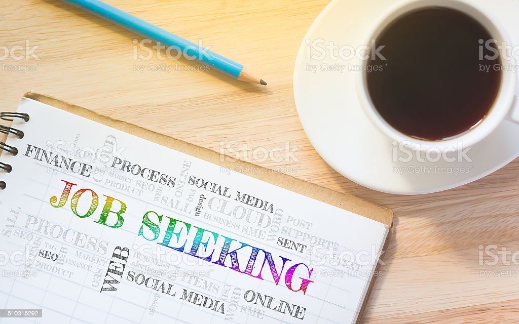 Concept JOB SEEKING message on book. stock photo
