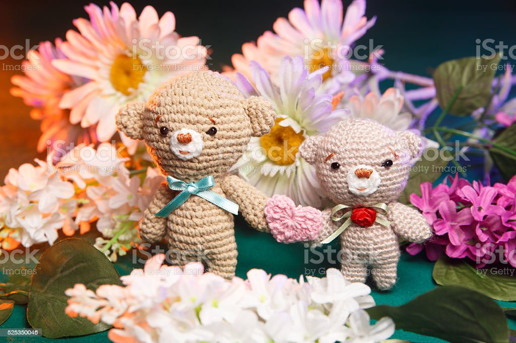 Concept: love, relationship. Couple of knitted bears holding hands stock photo