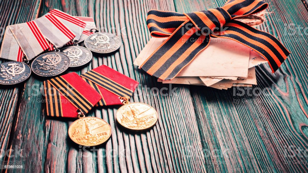 Concept May 9 St.Georges Ribbon medal award blade old photos. Victory Day. May 9. stock photo