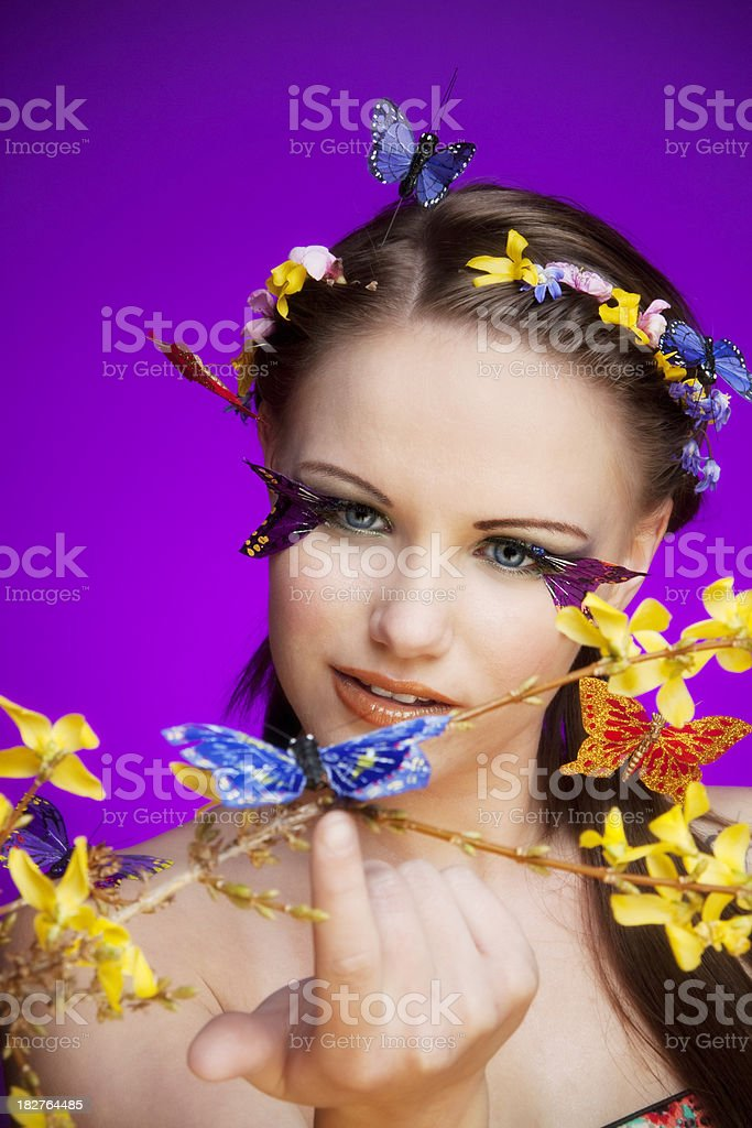 Concept - Miss Spring talking to a butterfly stock photo