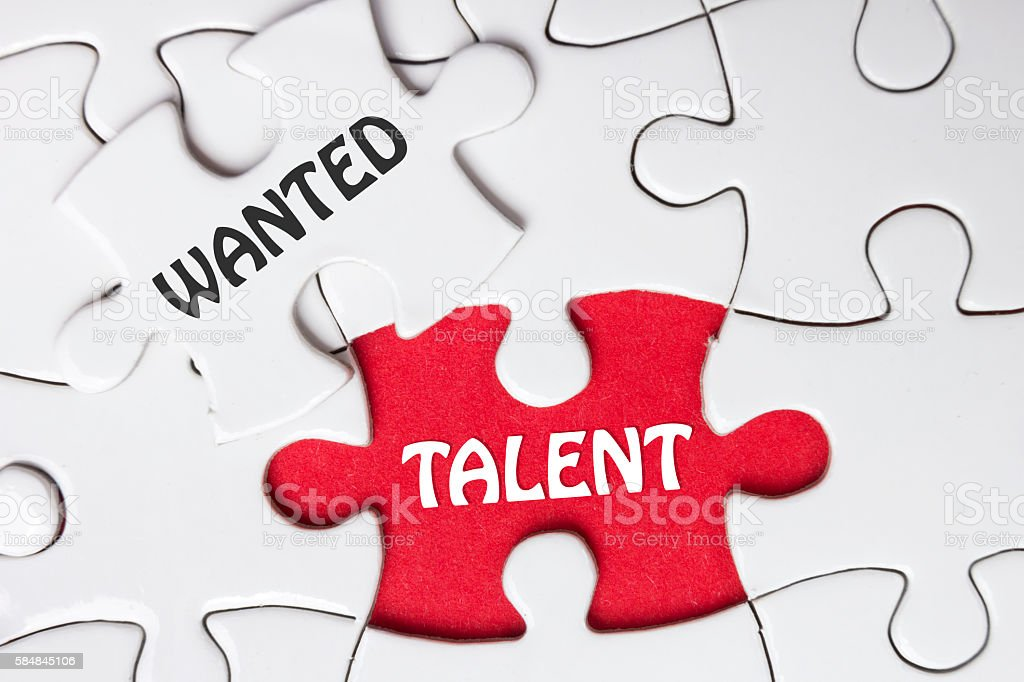 HIRING concept. Missing Piece Jigsaw Puzzle with word Talent Wanted stock photo