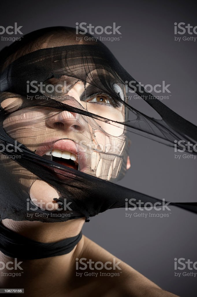 Beautiful Young Woman Model Ripping Through Net, Head Shot royalty-free stock photo