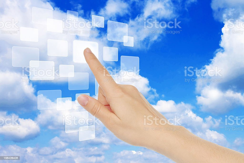 Concept of a finger using clouds as a computer royalty-free stock photo