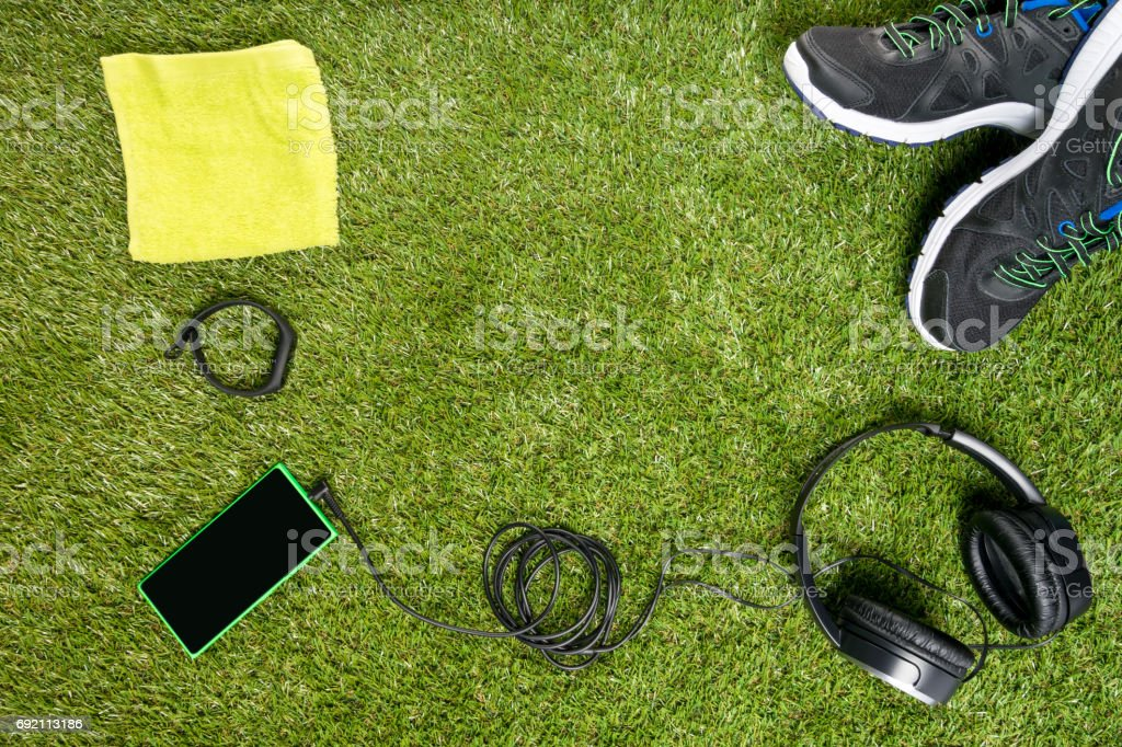 Concept of a set for sport on a background of a green lawn stock photo