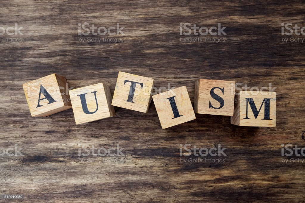 concept of autism word on wooden cubes stock photo