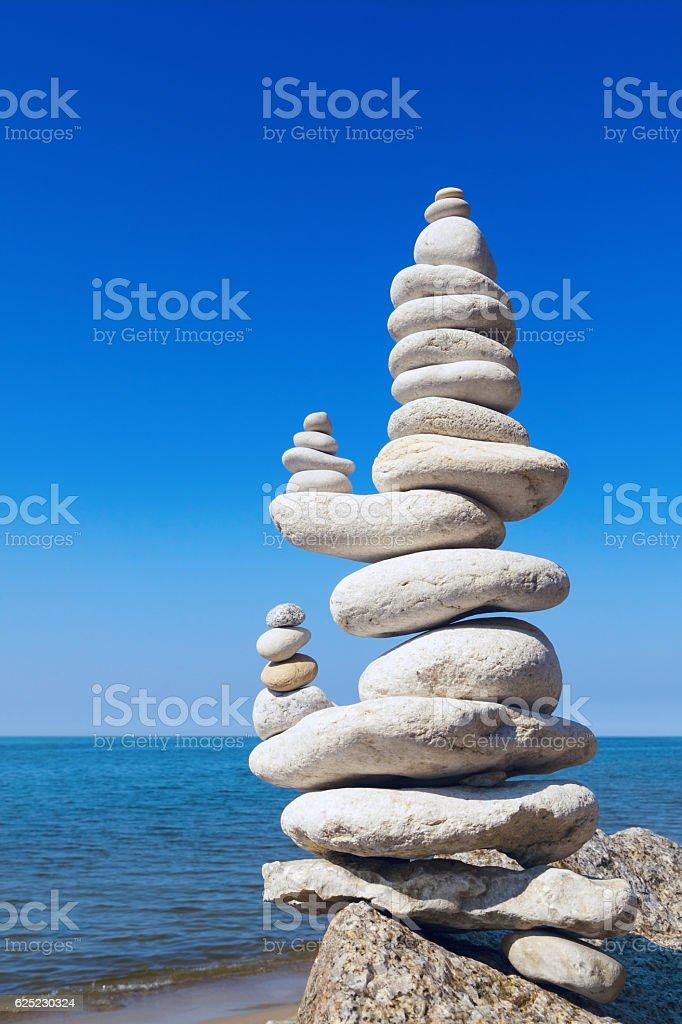 Concept of balance and harmony. White rocks zen on the stock photo