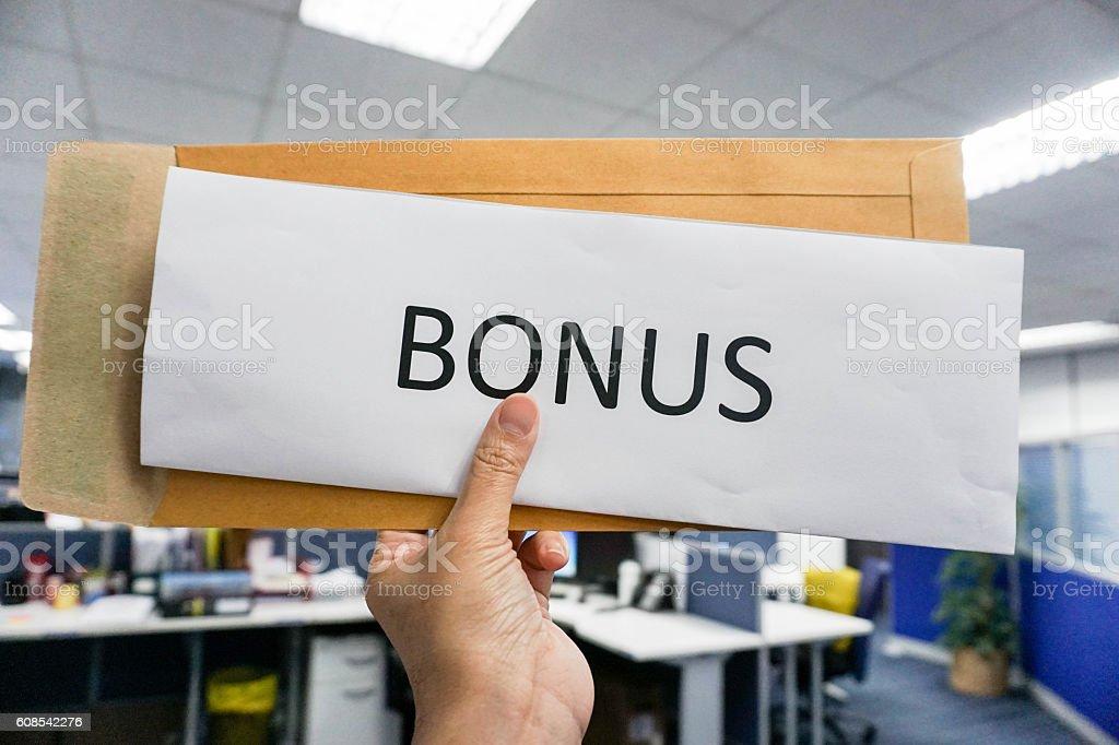 Concept of bonus by pulling paper of bonus from the envelope stock photo