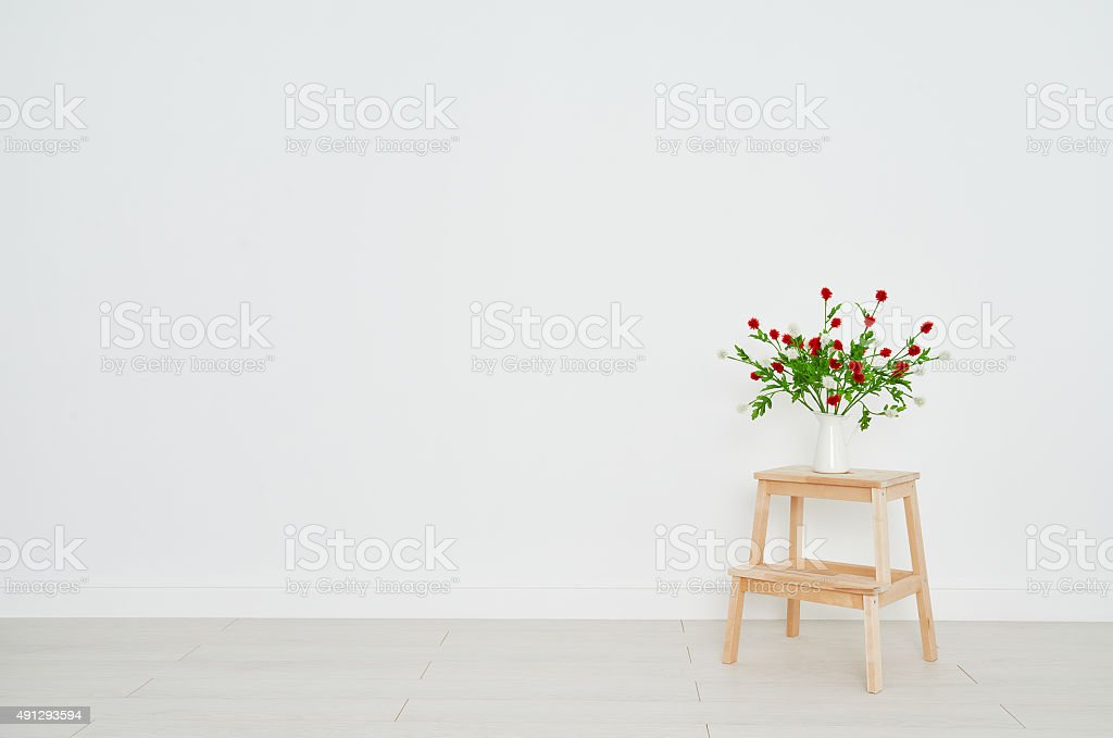 concept of  bouquet of flowers on  stepladder on background whit stock photo