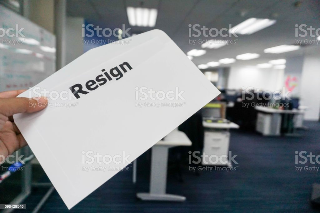 concept of business people submit resignation letter in office stock photo