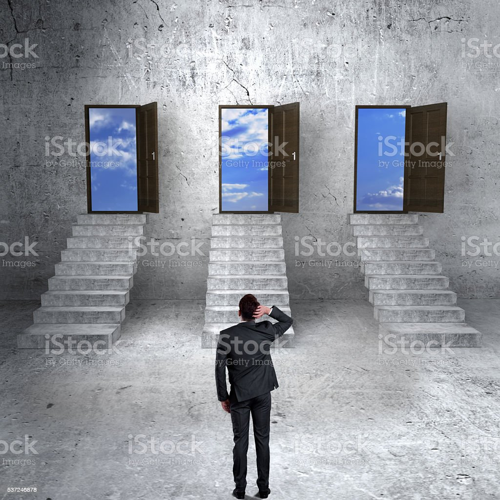 Concept of businessman choosing the right door stock photo