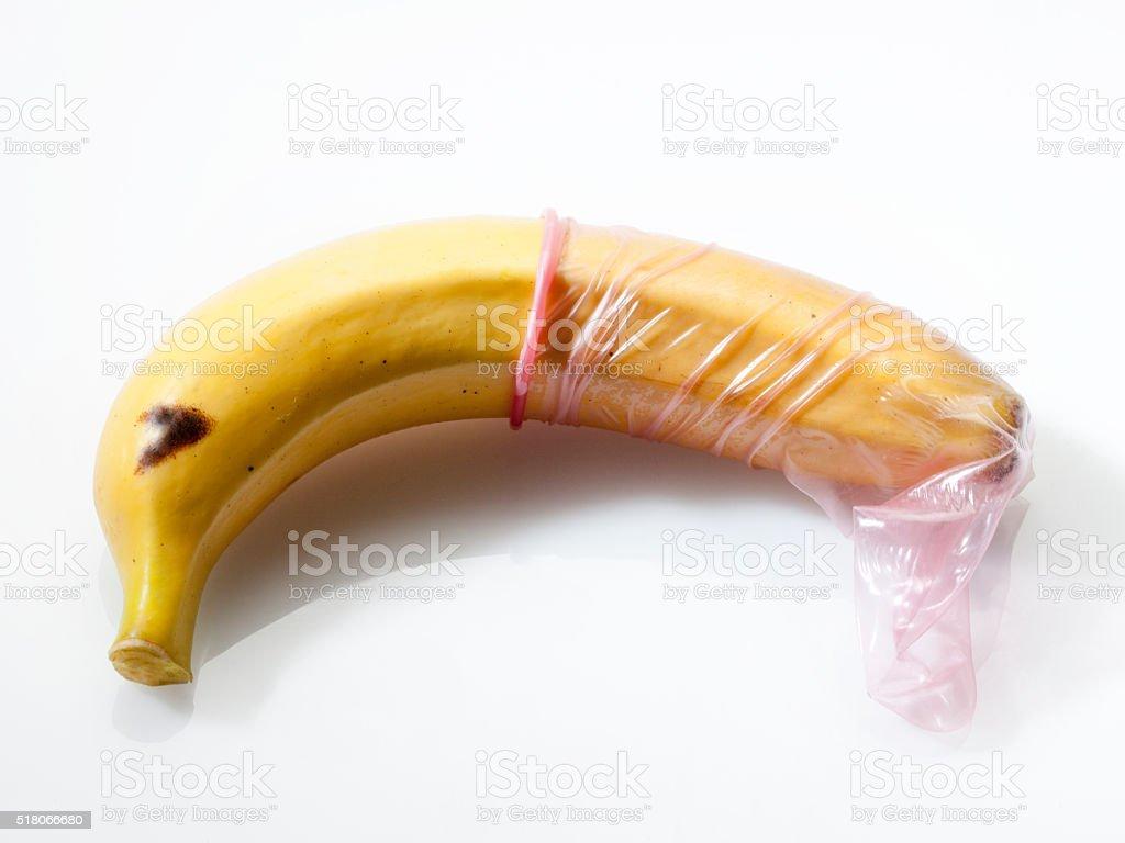concept of condom on banana stock photo