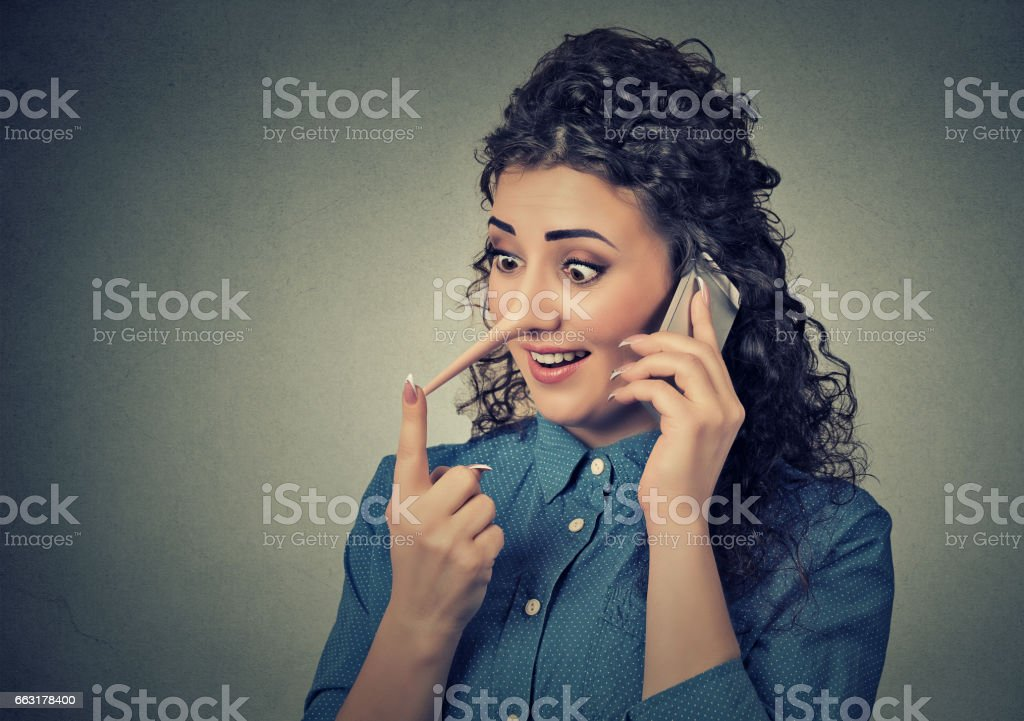 Concept of customer support representative liar with long nose. stock photo