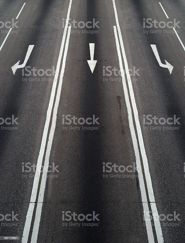 Concept of different directions using painted arrows on road stock photo