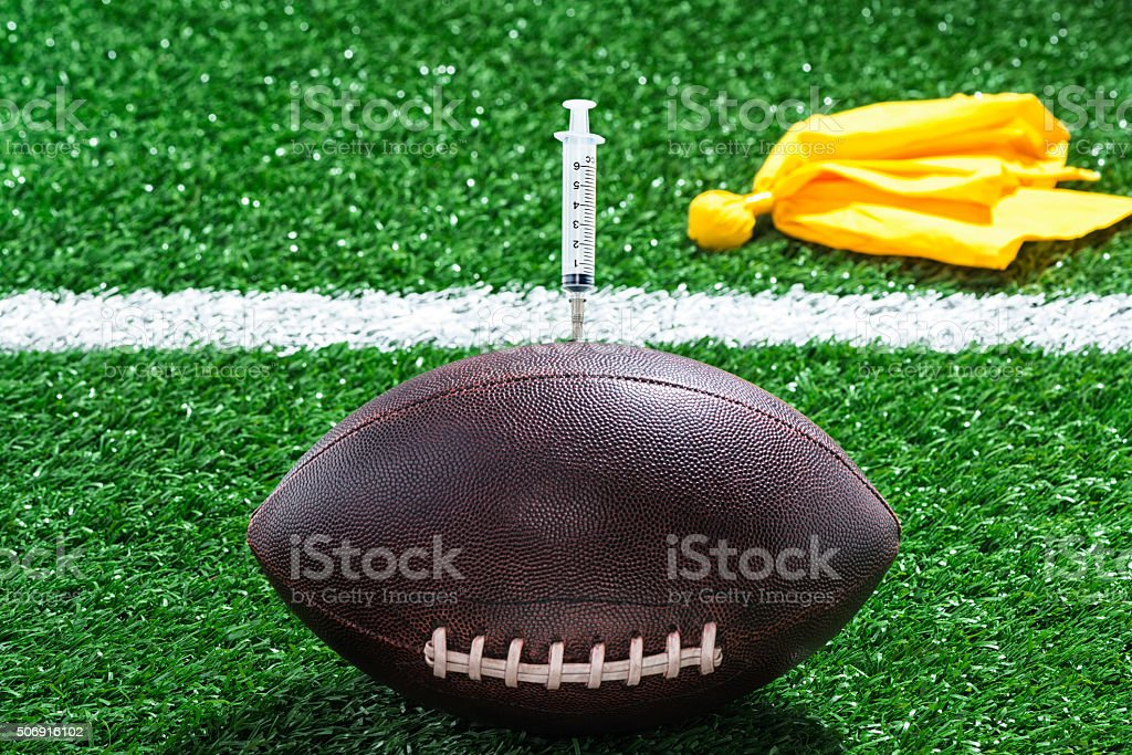 Concept of doping in American Football stock photo