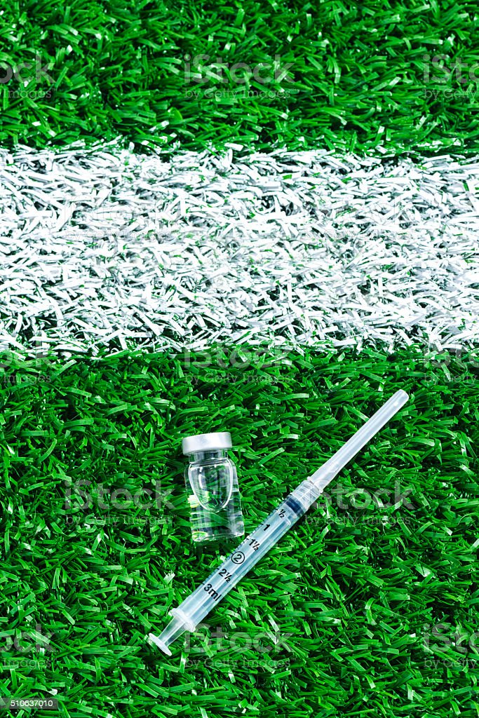 Concept of doping in Professional Sports with syringe and vial stock photo