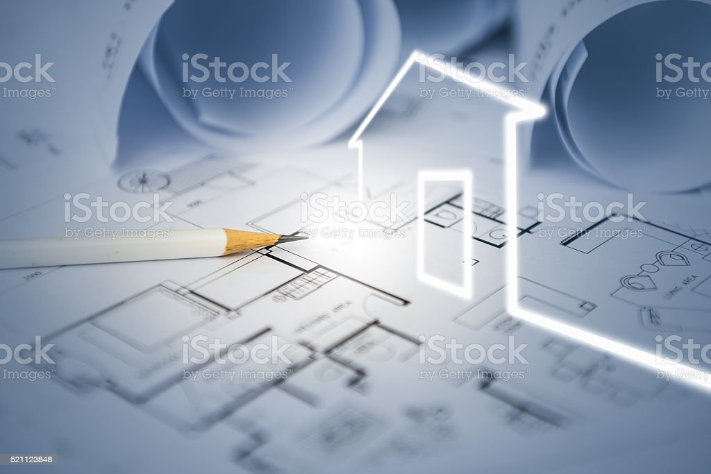 concept of dream house draw by designer with construction drawin stock photo