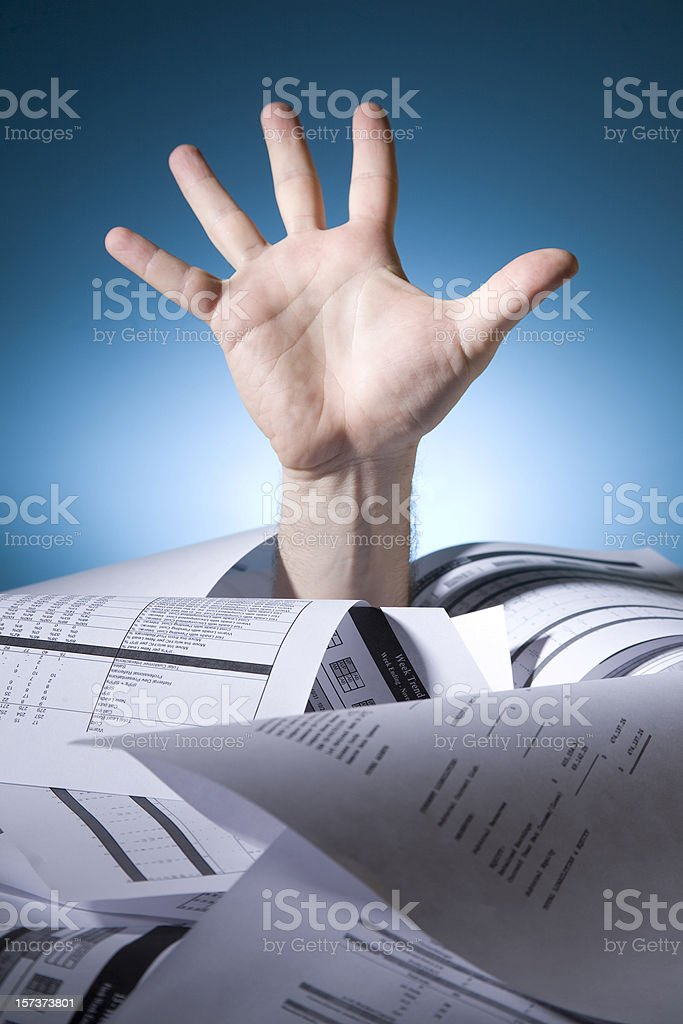 Concept of drowning in paperwork stock photo